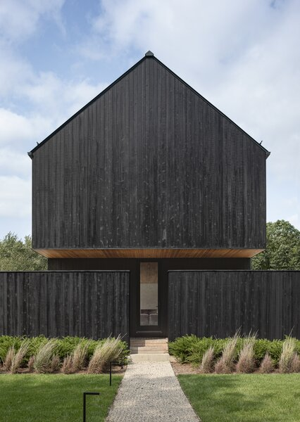 The owners of the Field House in South Kingstown, Rhode Island, wanted their home to have a sense of place within the forested plot of land.
