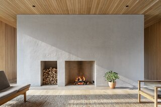 """Mac describes adding the fireplace's Domingue plaster finish as a real """"labor of love."""" """"The end result was a credit to the builder and his team. It really pulled the spaces together, and there is nothing better than the natural light playing with the plaster finish,"""" explains the architect."""