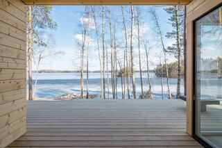A Log Cabin Kit Sauna Is Built Lakeside for a Post-Steam Plunge in Finland