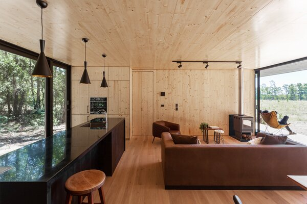 The home is composed of two modules, with a kitchen and common space at the center.