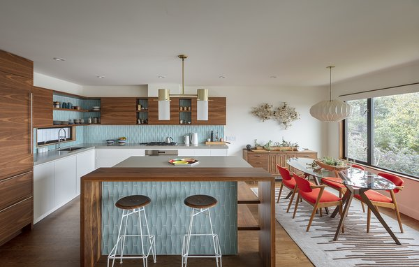A view into the airy, light-filled kitchen of 51 Nebraska by Todd Davis Architecture. The updated midcentury home pays homage to its roots.