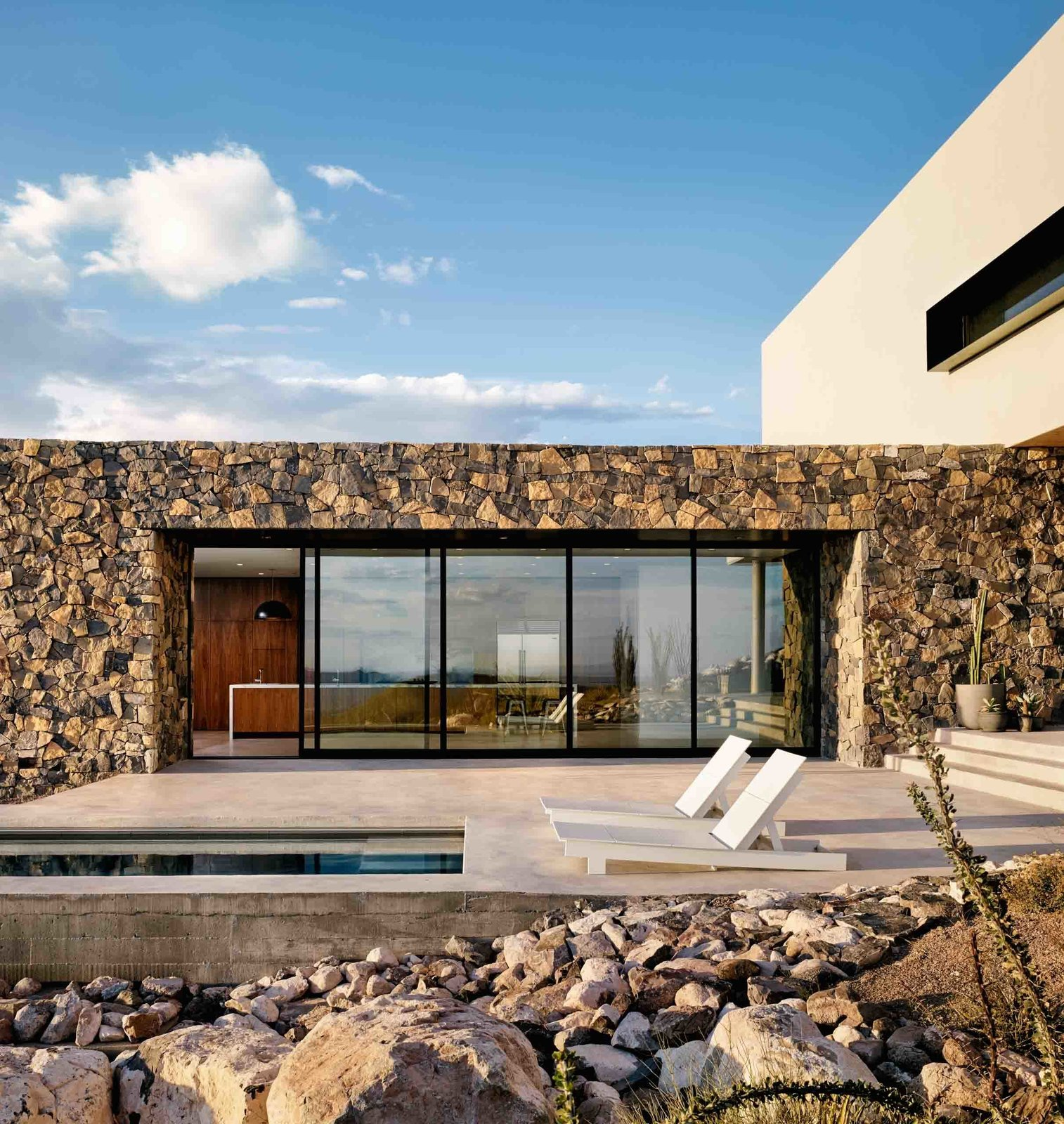 When the massive west-facing multi-slide door is open, cool Texas breezes course through the home's main volume.  West Texas Vistas