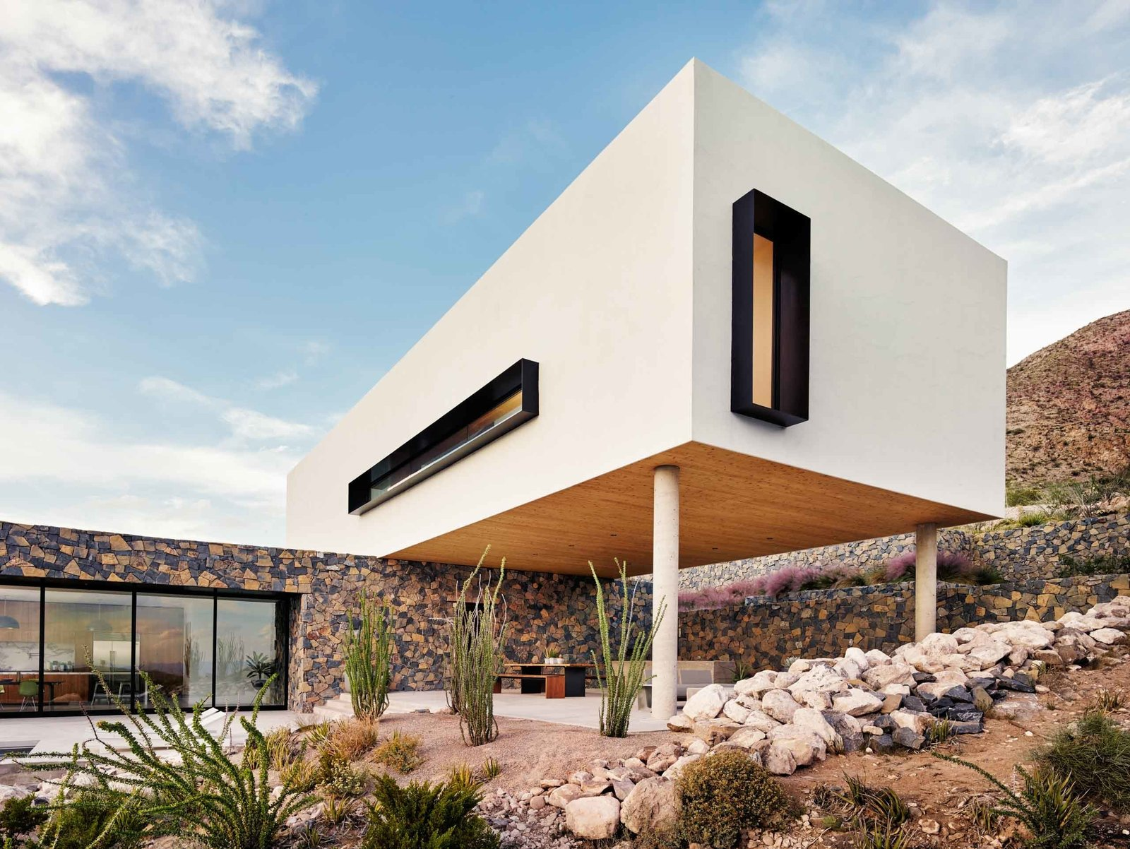 The white stucco volume stands out amid the rocky terrain of the Franklin Mountains near El Paso.  West Texas Vistas