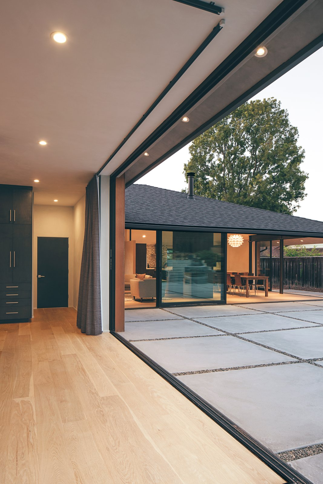 This view of the main living area from inside the master bedroom shows how two 90-degree multi-slide doors seamlessly blend the indoors with the outside.  A Perfect Match