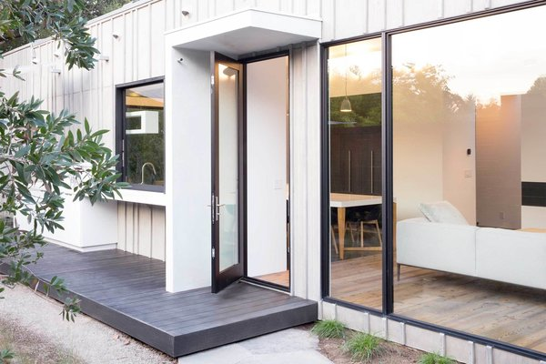 A hinged door allows further access to the backyard.