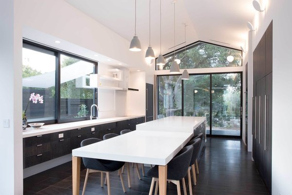 The kitchen benefits from a multi-slide door and a large operable window that let fresh Santa Barbara breezes course through the space.