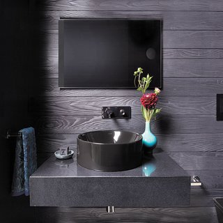 All black powder room with Cambria Black and Kohler Vox sink