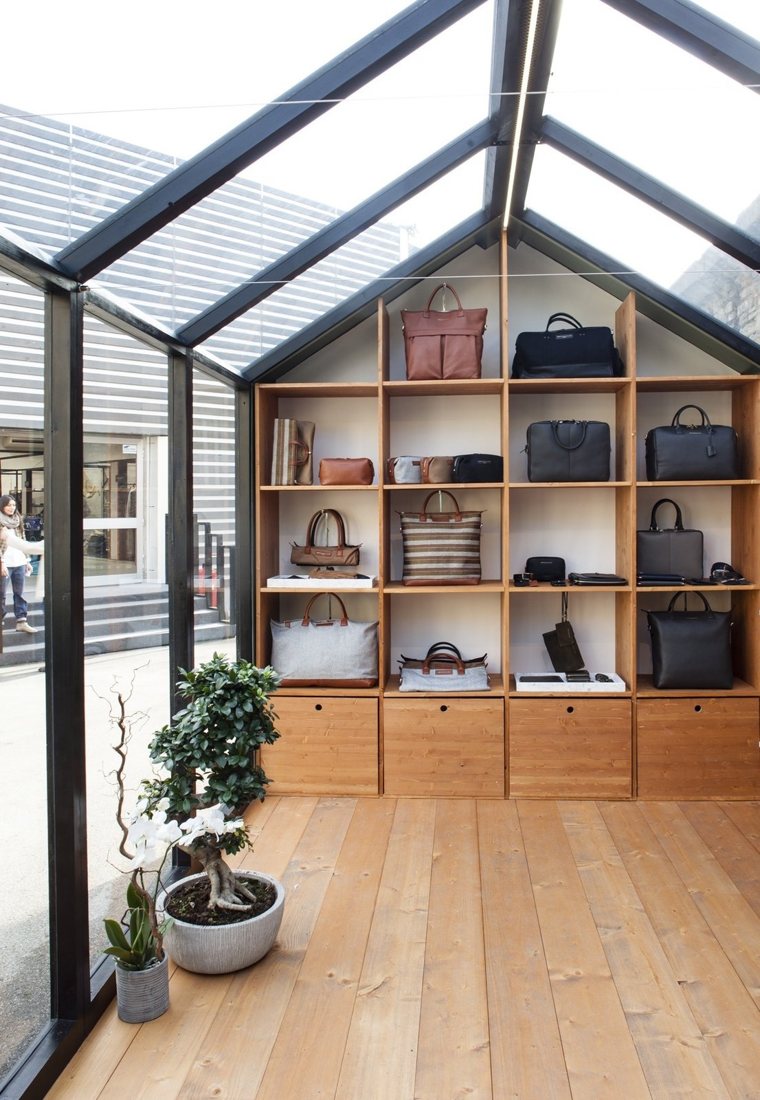 The structure features custom millwork to display the brand's bags and accessories.  Photo 7 of 8 in The Alpine Lodge by WANT Les Essentiels de la Vie