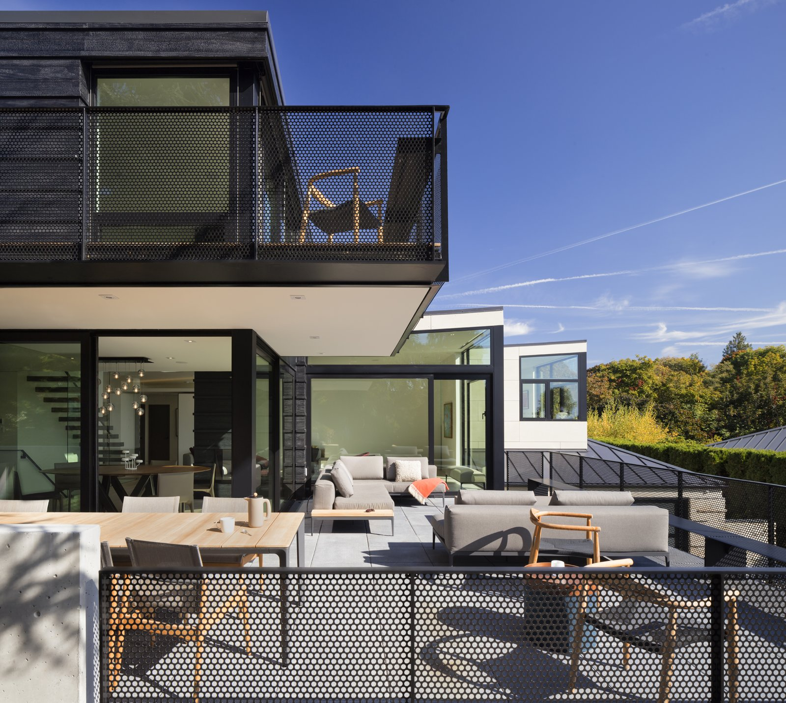 Exterior, Stone Siding Material, Concrete Siding Material, Glass Siding Material, Metal Roof Material, House Building Type, Flat RoofLine, Wood Siding Material, Metal Siding Material, and Shed RoofLine Terrace and Upper Deck  David Coleman / Architecture's Favorites from Bay View Residence