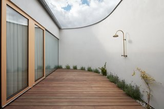 The outdoor atrium of Family House Litvínovice is a completely private space that's well-suited for the installation of a hammock, outdoor bath, or shower. A11 designed the home to be an exploration of minimalism and privacy from the outside world.