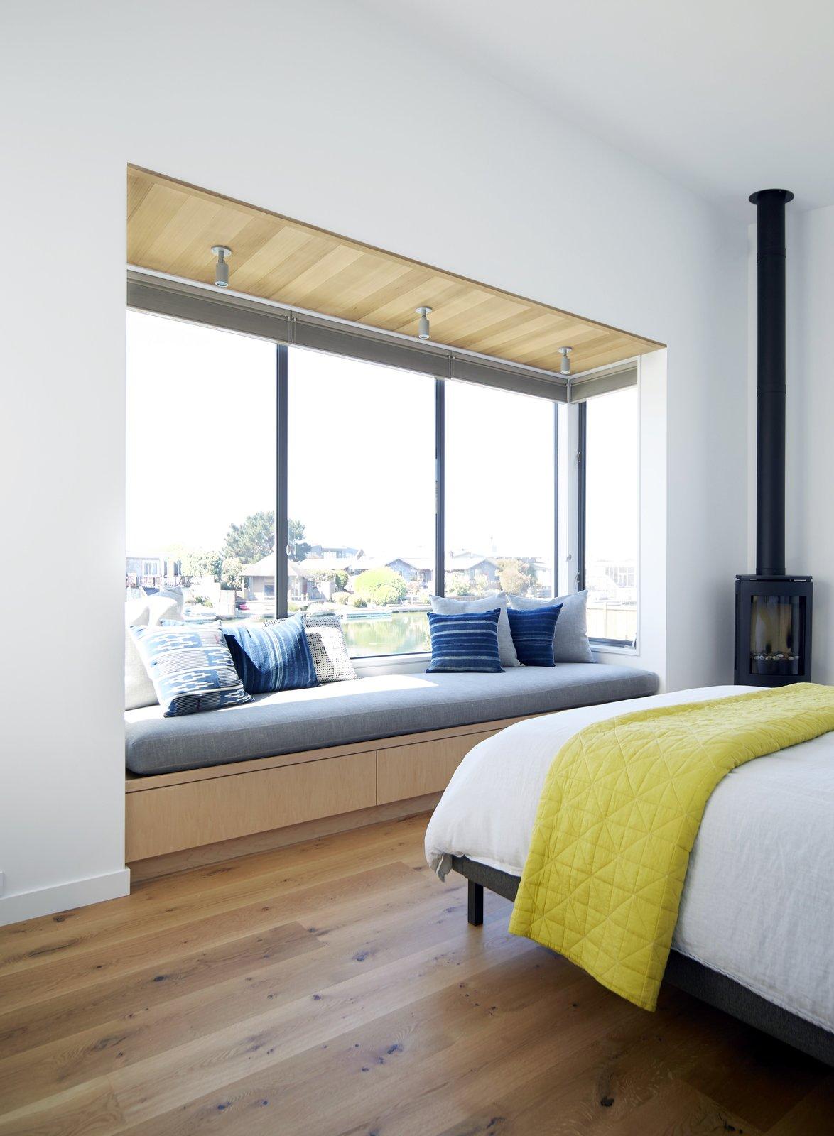 #TurnbullGriffinHaesloop #interior #bedroom #windowseat #woodburningstove    Stinson Beach Lagoon Residence by Turnbull Griffin Haesloop Architects