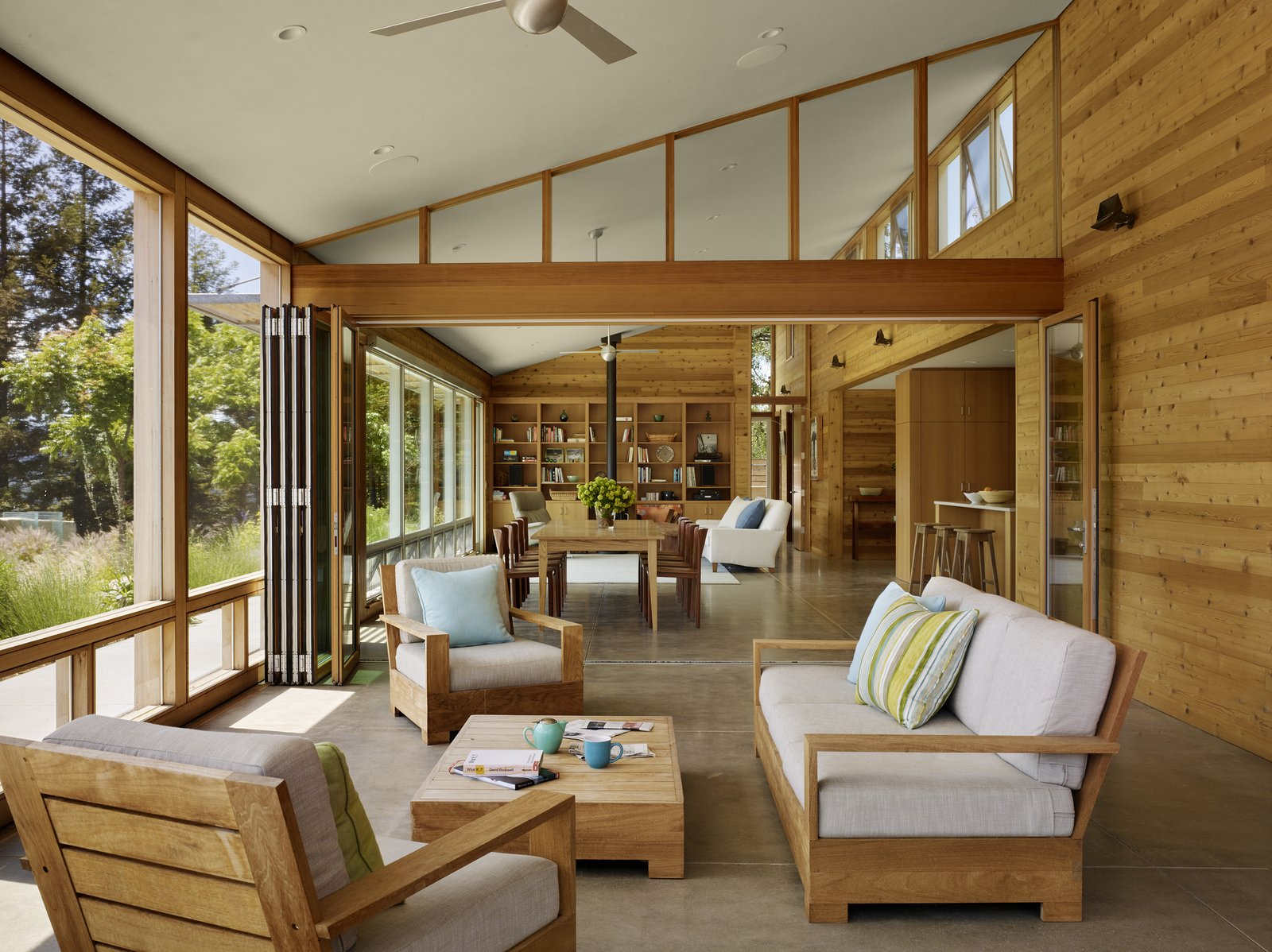 Living Room, Chair, Recessed Lighting, Sofa, Concrete Floor, and Coffee Tables #TurnbullGriffinHaesloop #interior #nanawall #screenedporch #diningroom #window  Cloverdale Residence by Turnbull Griffin Haesloop Architects