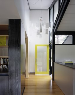 Entry hall with Ingo Mauer chandelier
