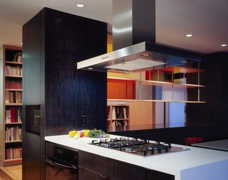 Kitchen peninsula and plexiglas shelving