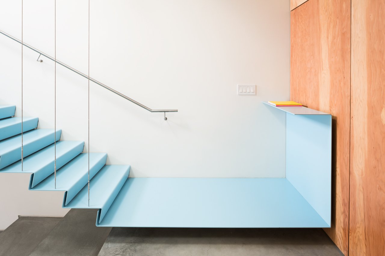 Staircase, Metal Tread, and Metal Railing The staircase has a floating metal landing that connects to a fir plywood wall.  Photo 4 of 10 in A Creative Agency with a Modern, Open Workspace