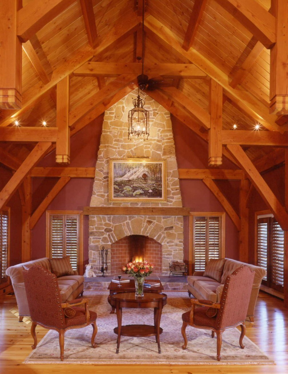 Custom Timberpeg Hammer Beam Truss and Grand Fireplace in the Formal Great Room   Yellow Brook Farm House by Timberpeg