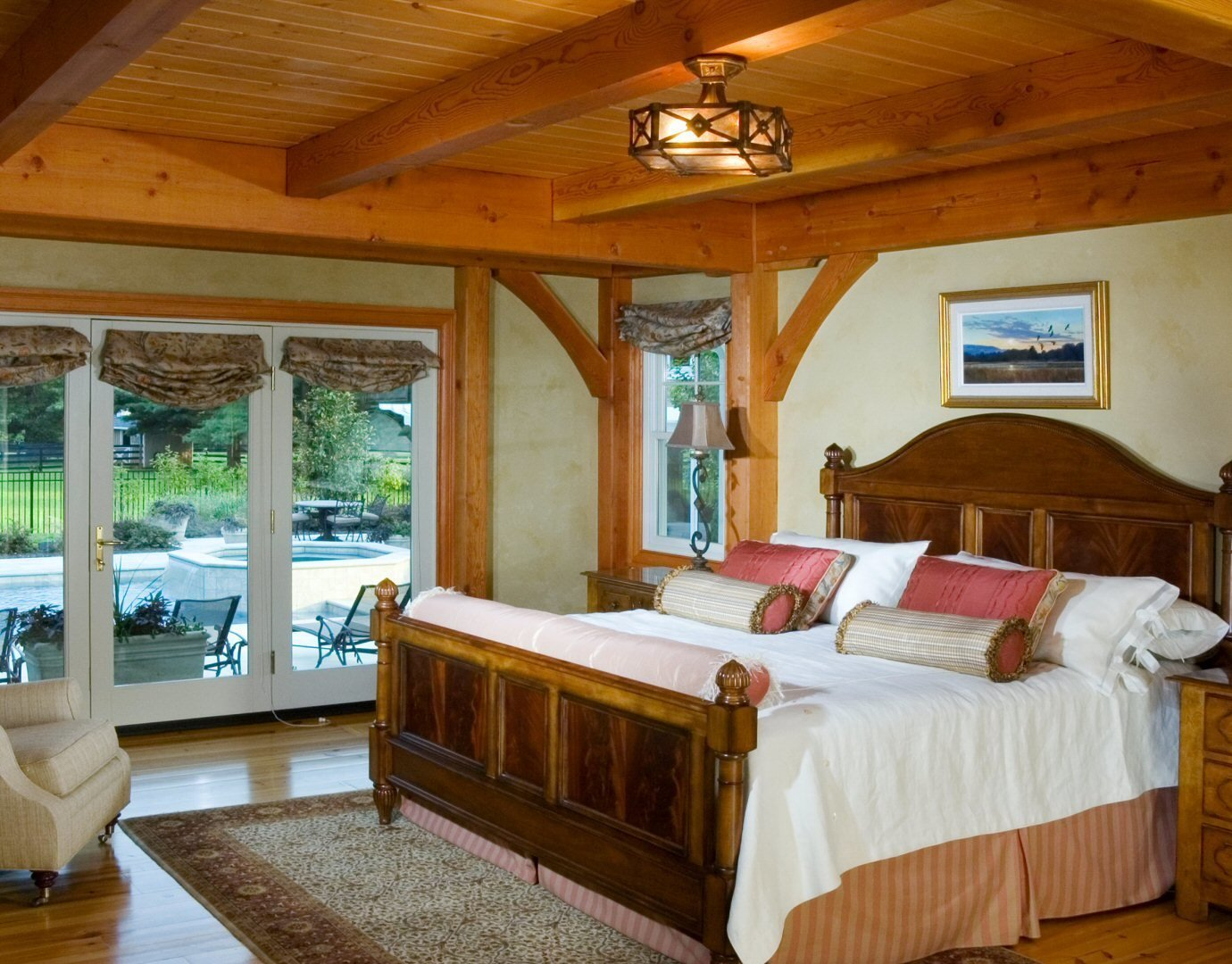 The Timber Framed Master Bedroom has Direct Pool Access  Yellow Brook Farm House by Timberpeg