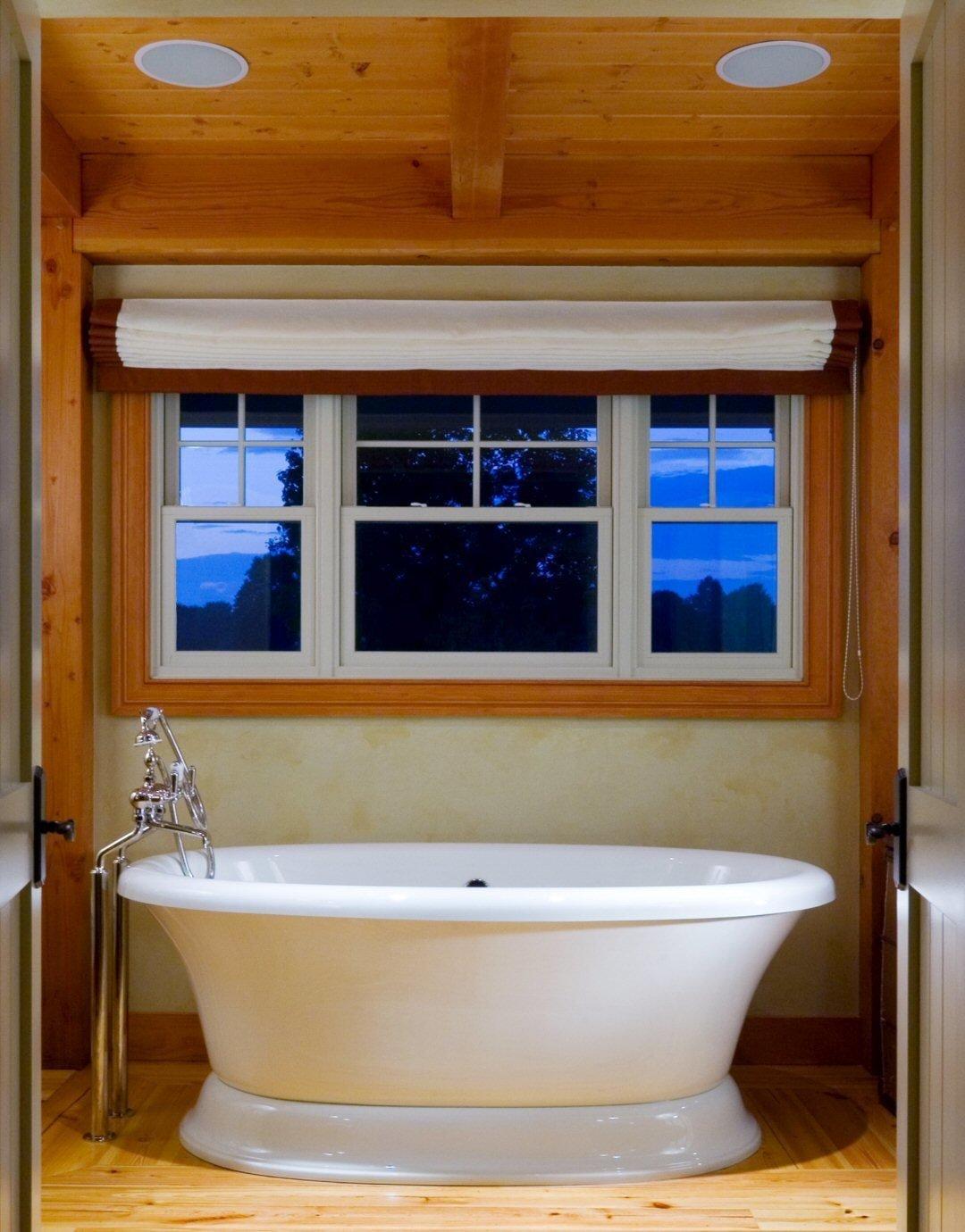 Deep Soaking Tub in the Master Bathroom  Yellow Brook Farm House by Timberpeg