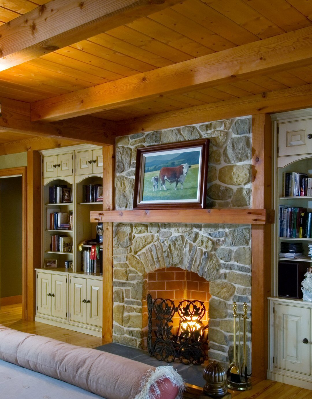 A Cozy Fireplace Adds a Bit of Intimacy to this Master Bedroom Suite  Yellow Brook Farm House by Timberpeg