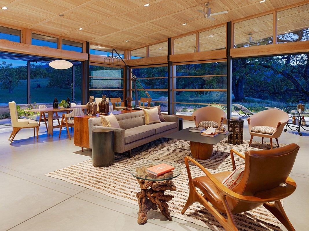Living Room, Chair, Sofa, and Pendant Lighting Caterpillar House  Caterpillar House
