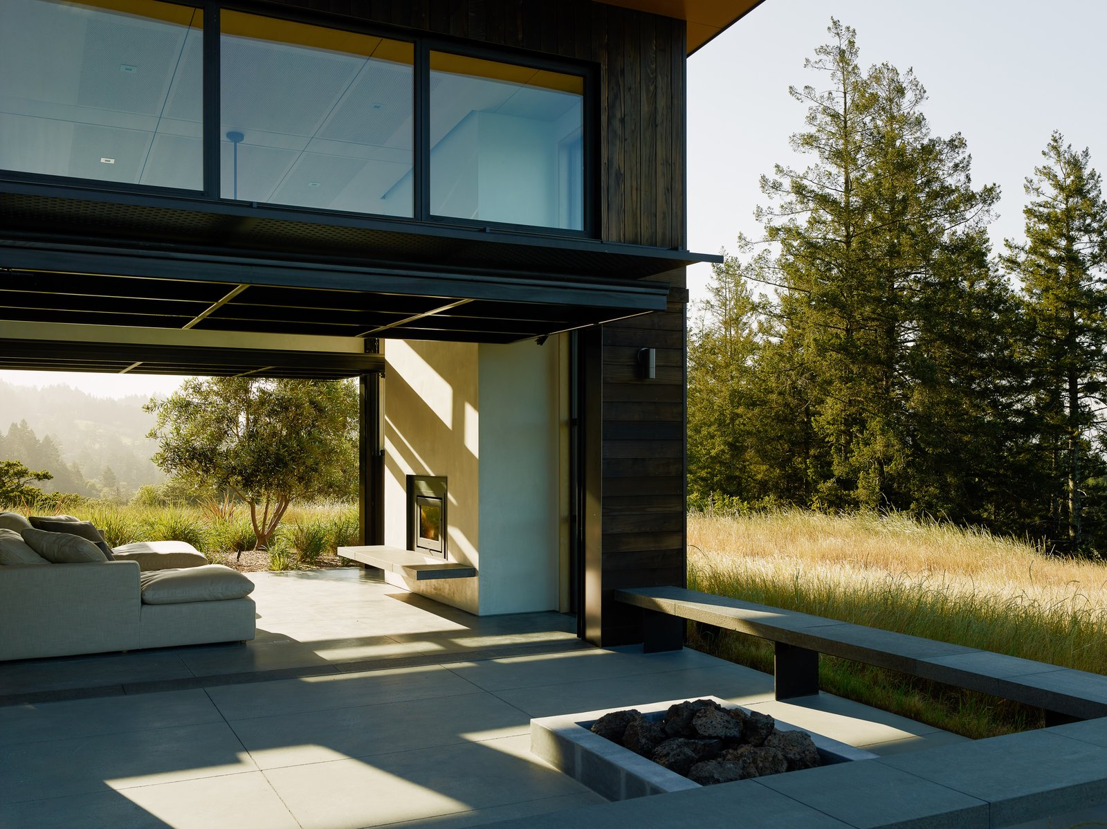 Outdoor, Side Yard, Shrubs, Concrete Patio, Porch, Deck, and Large Patio, Porch, Deck The expansive Northern Californian landscape seamlessly enters the home.  Photos from Sonoma Wine Country I