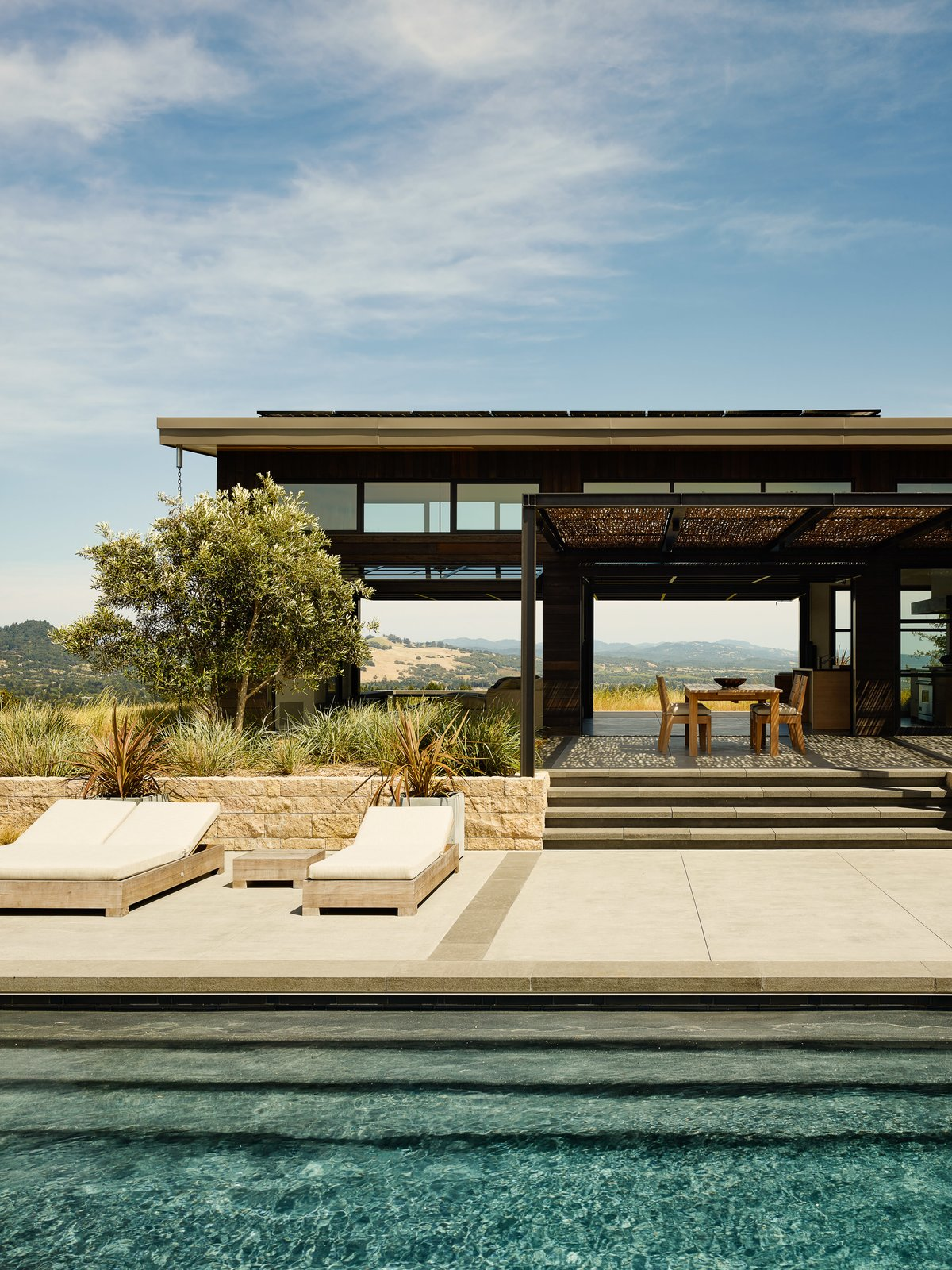 Outdoor, Large Patio, Porch, Deck, Large Pools, Tubs, Shower, Stone Patio, Porch, Deck, Back Yard, Concrete Patio, Porch, Deck, and Shrubs Sonoma Wine Country I  Photo 6 of 10 in Four Enormous Glass Doors Turn This Northern California Home Into an Outdoor Pavilion from Sonoma Wine Country I