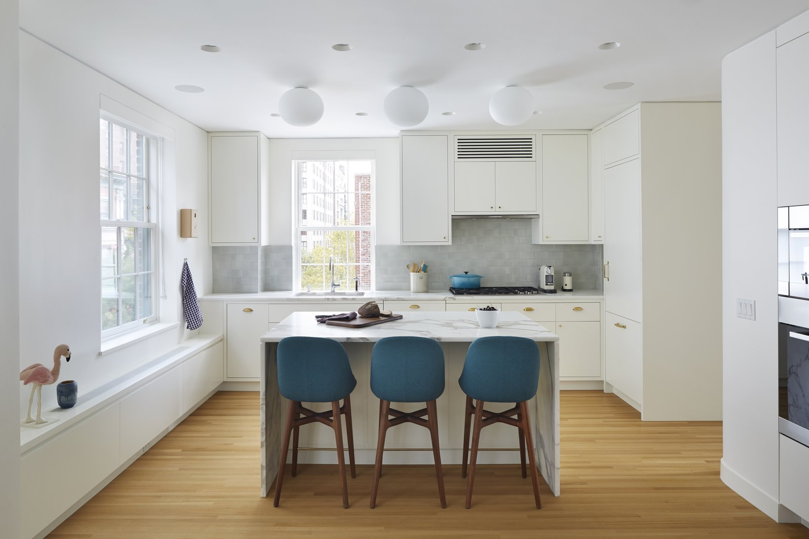 View from the dining area towards the kitchen.  5th Avenue Residence by pulltab