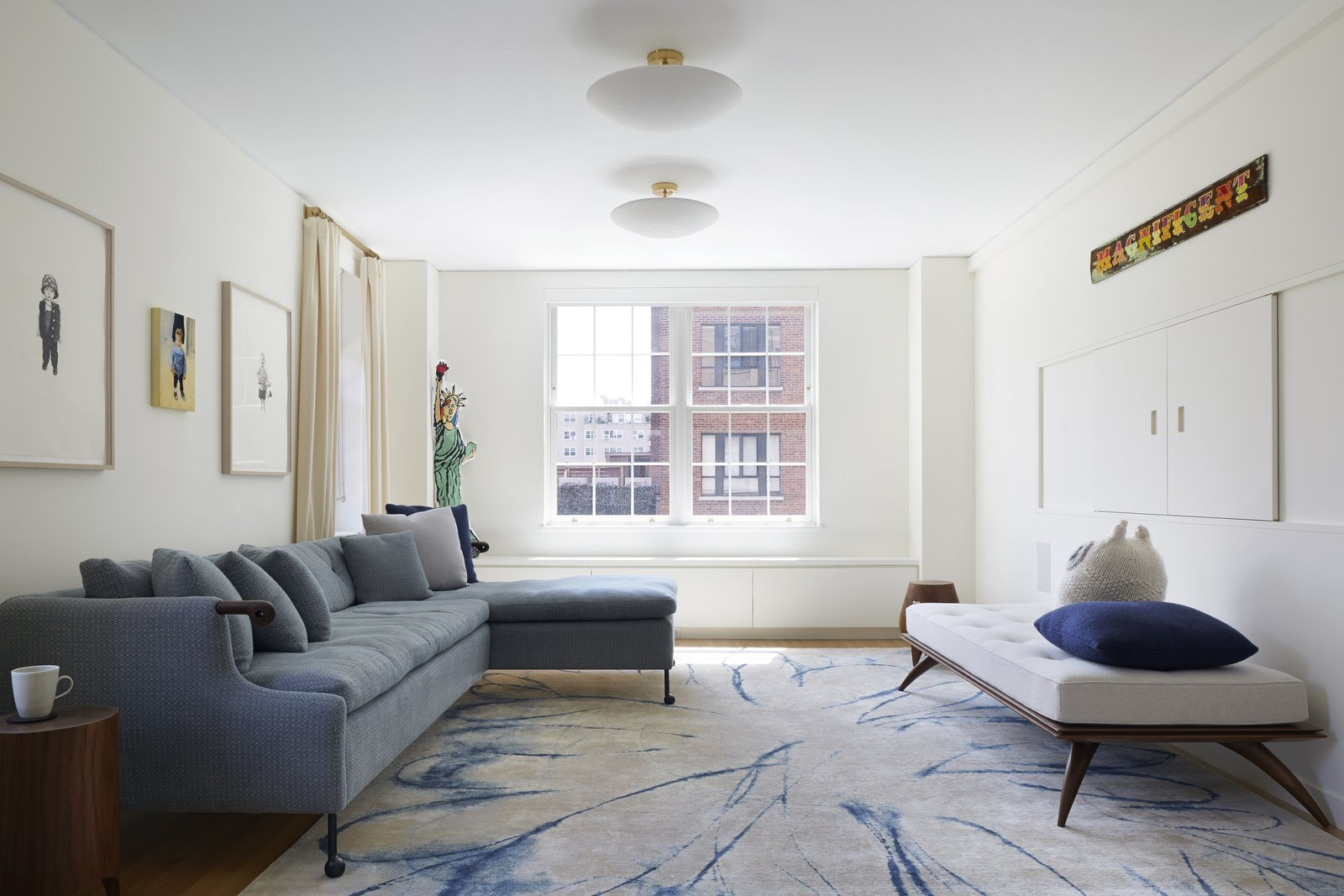 View from the entry to the Living Room.  Furniture by BDDW, Paul Mathieu and Kieran Kinsella.  The area rug is by Fort Street Studio.  The cast plaster ceiling fixtures are by Pulltab and Remains Lighting.  5th Avenue Residence by pulltab