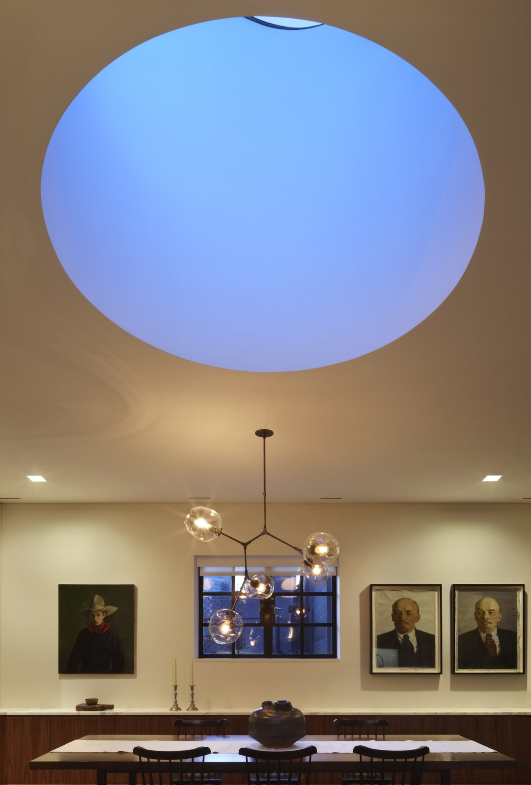 A view of the drum skylight at dusk.  Early in the design process we discussed with our clients the work of James Turrell including a field trip to Meeting at MoMA PS1 on a very cold but wonderfully quiet day.  One of the things we really like about Mr. Turrell's work is the flattening of perspective while creating a meditative balance between lightness and weight.  Here the drum skylight while physically large recedes into the ceiling plan  White Street Residence by pulltab