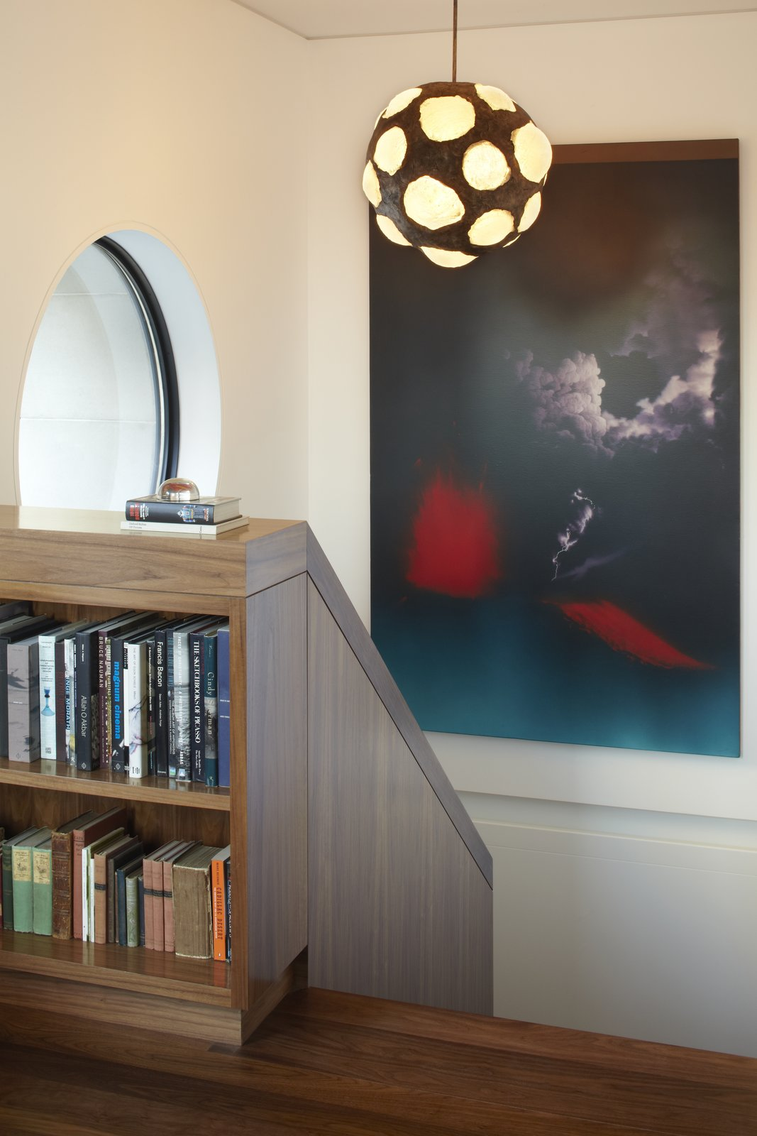 """A close up detail of the built-in bookcase at the top landing of the stair.  This photo shows how 1/8"""" reveals are used to subtly express how the individual pieces are joined on site.  White Street Residence by pulltab"""