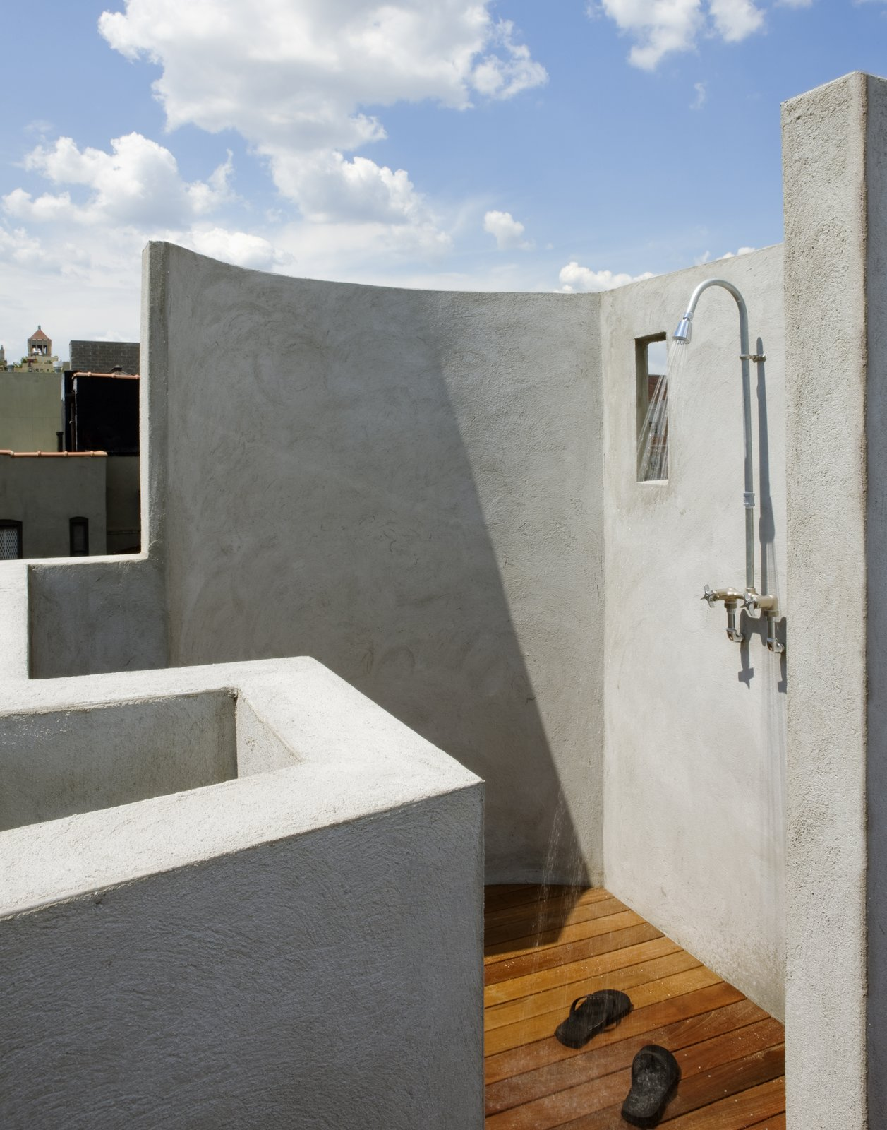 Outdoor The outdoor shower with built-in bench and Ipe deck.  The shower fitting was made from off the shelf parts sourced from a local plumbing supply house.  East Village Roof Garden