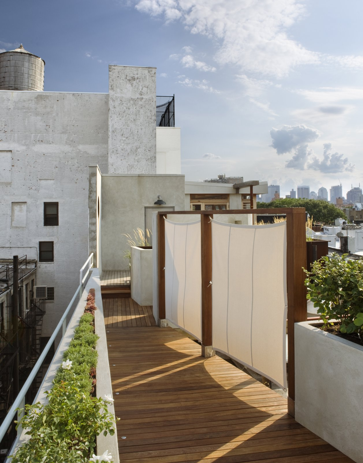 Walking back down the ramp toward the penthouse in the late afternoon sun.  East Village Roof Garden
