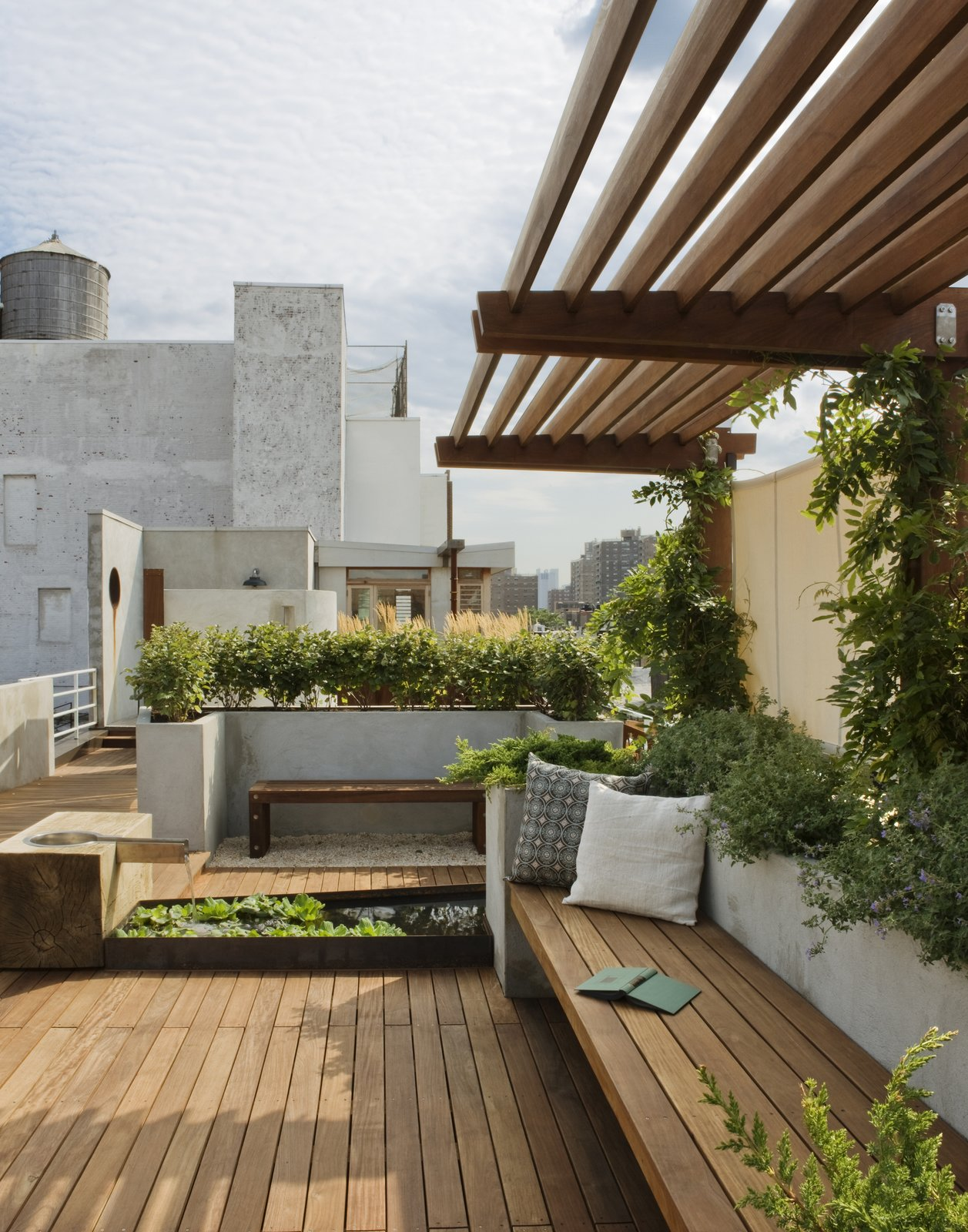 Outdoor, Rooftop, Raised Planters, Gardens, Walkways, Shrubs, Small Patio, Porch, Deck, Wood Patio, Porch, Deck, and Decking Patio, Porch, Deck A view looking south toward the penthouse addition.  The pergola is planted with wisteria providing a welcoming shade.  East Village Roof Garden