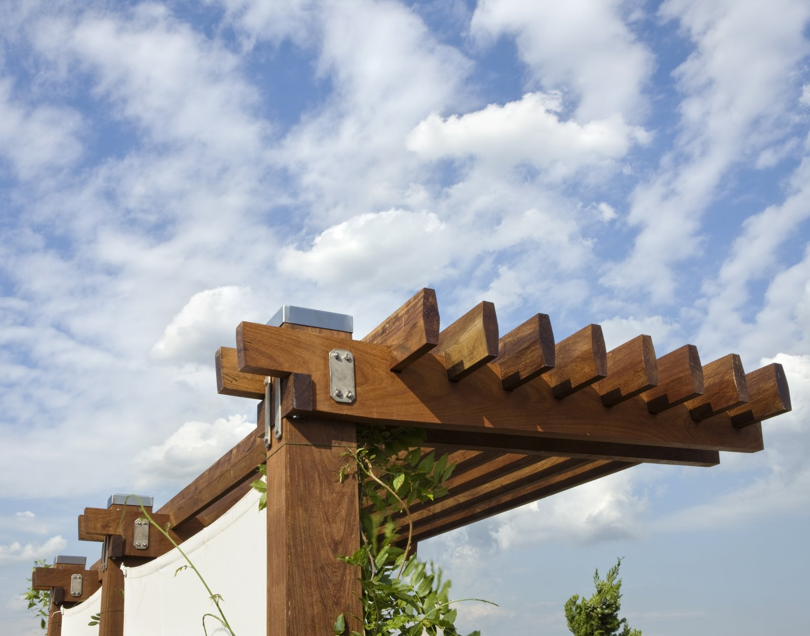 The pergola was fabricated from solid Ipe and is assembled using stainless steel bolts and plates.  East Village Roof Garden