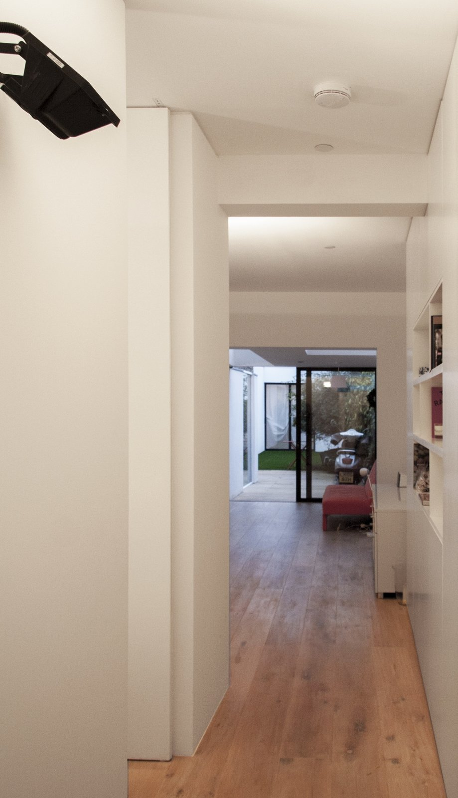 From the entry one gets elongated views toward the back of the scheme but the full extent of the space is elusive, with glimpsed views into spaces beyond, both laterally and longitudinally.  Unité de Rénovation