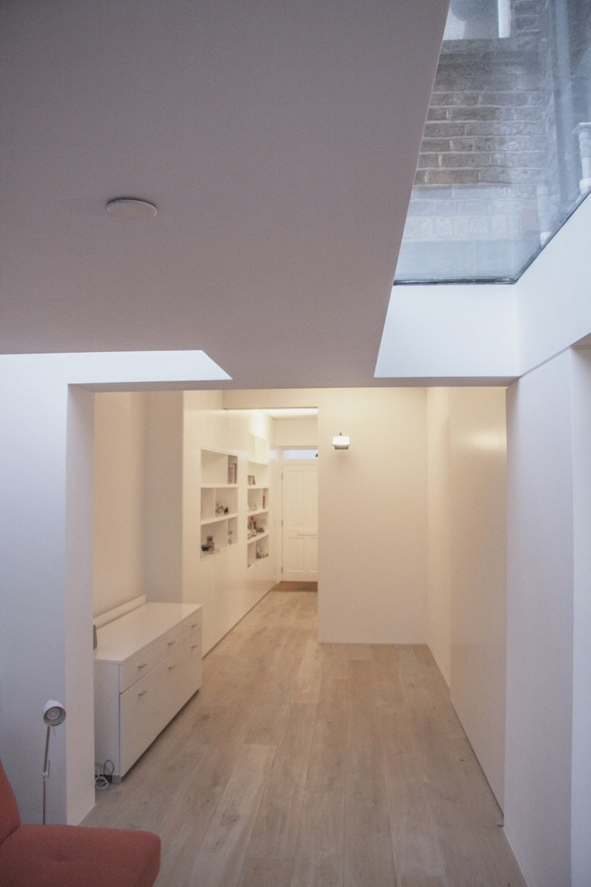 Roof-lights provide views of the sky and loosely delineate the living space from the adjacent entry and dining spaces.  Unité de Rénovation