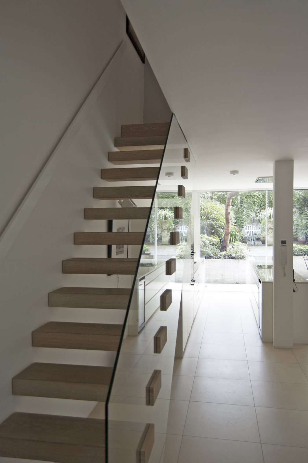 Staircase, Wood Tread, and Glass Railing The modern lower-ground floor connects to the rest of the house via an open-riser timber staircase with clear glass balustrade.  Soupçon Brut by WILLIAM TOZER Associates