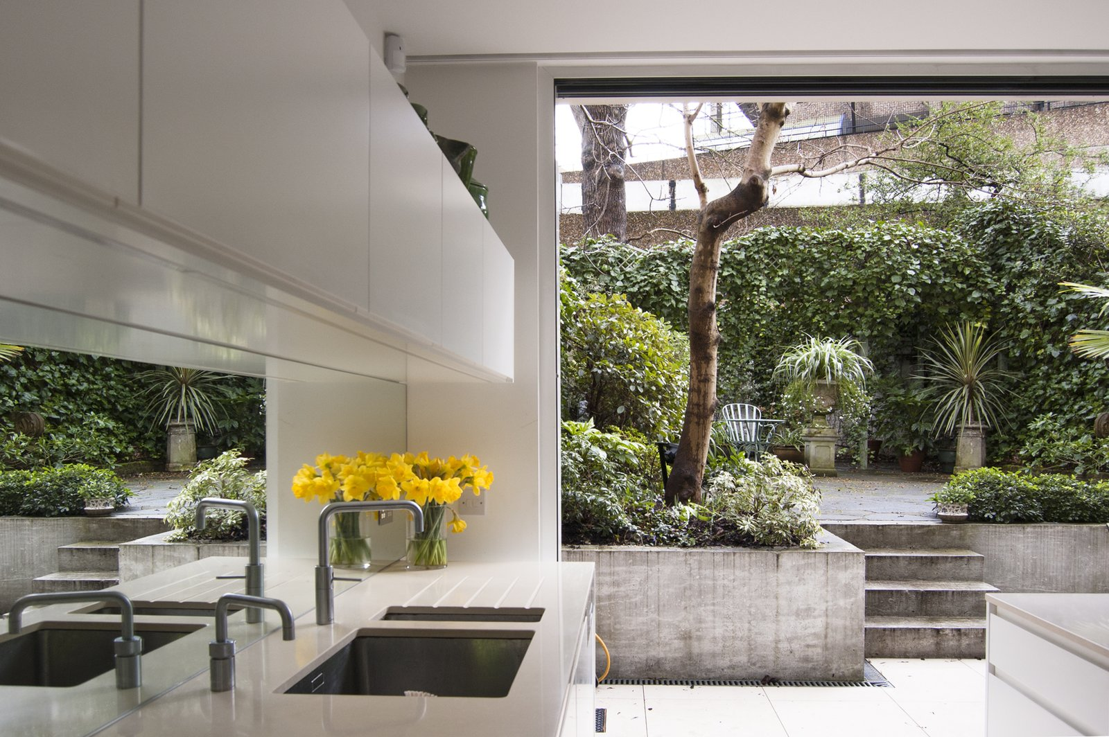 Kitchen, White, Mirror, Ceramic Tile, and Undermount The brutalist council estate to the rear is viewed as a found-object artwork through a new cast-concrete and stark white frame.  Best Kitchen Mirror White Photos from Soupçon Brut