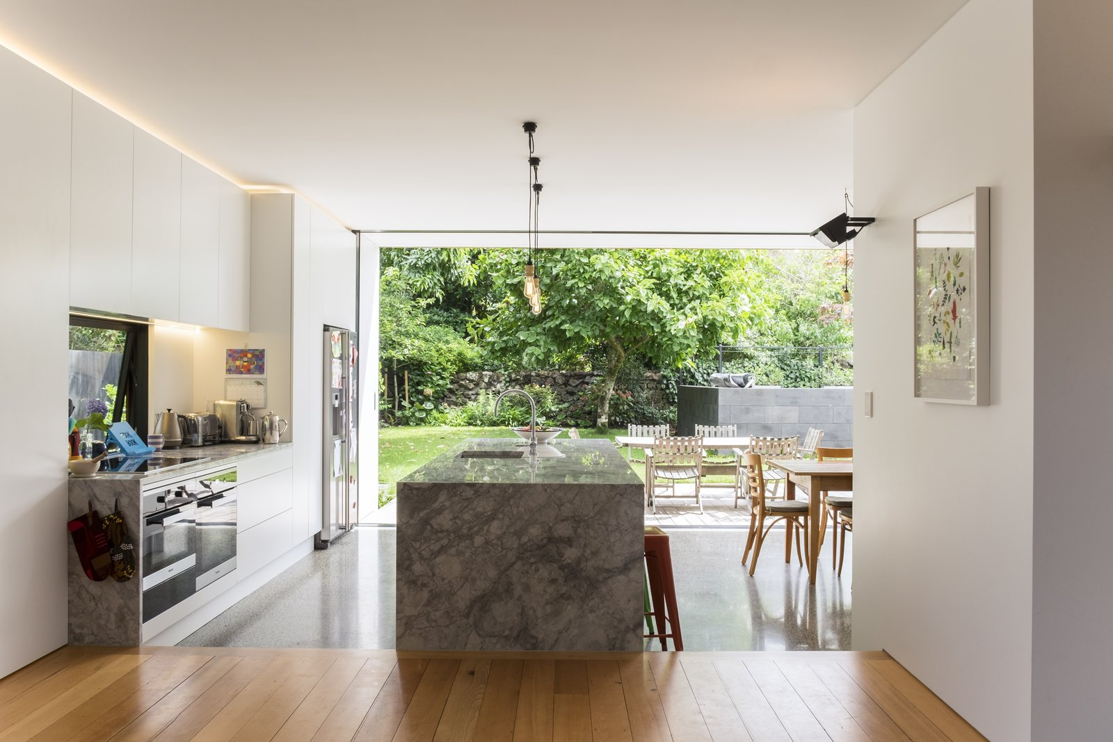 The new interiors are open-plan, but loosely divided into zones of use by rectilinear planes and volumes that accommodate the kitchen and other storage.