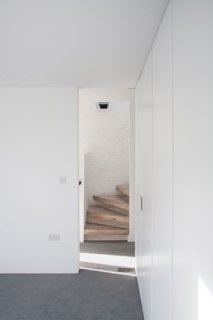 The status of the salvage floorboards as an historical found object is further challenged by their use to clad the modern, open-riser staircase that connects the second and third floors.