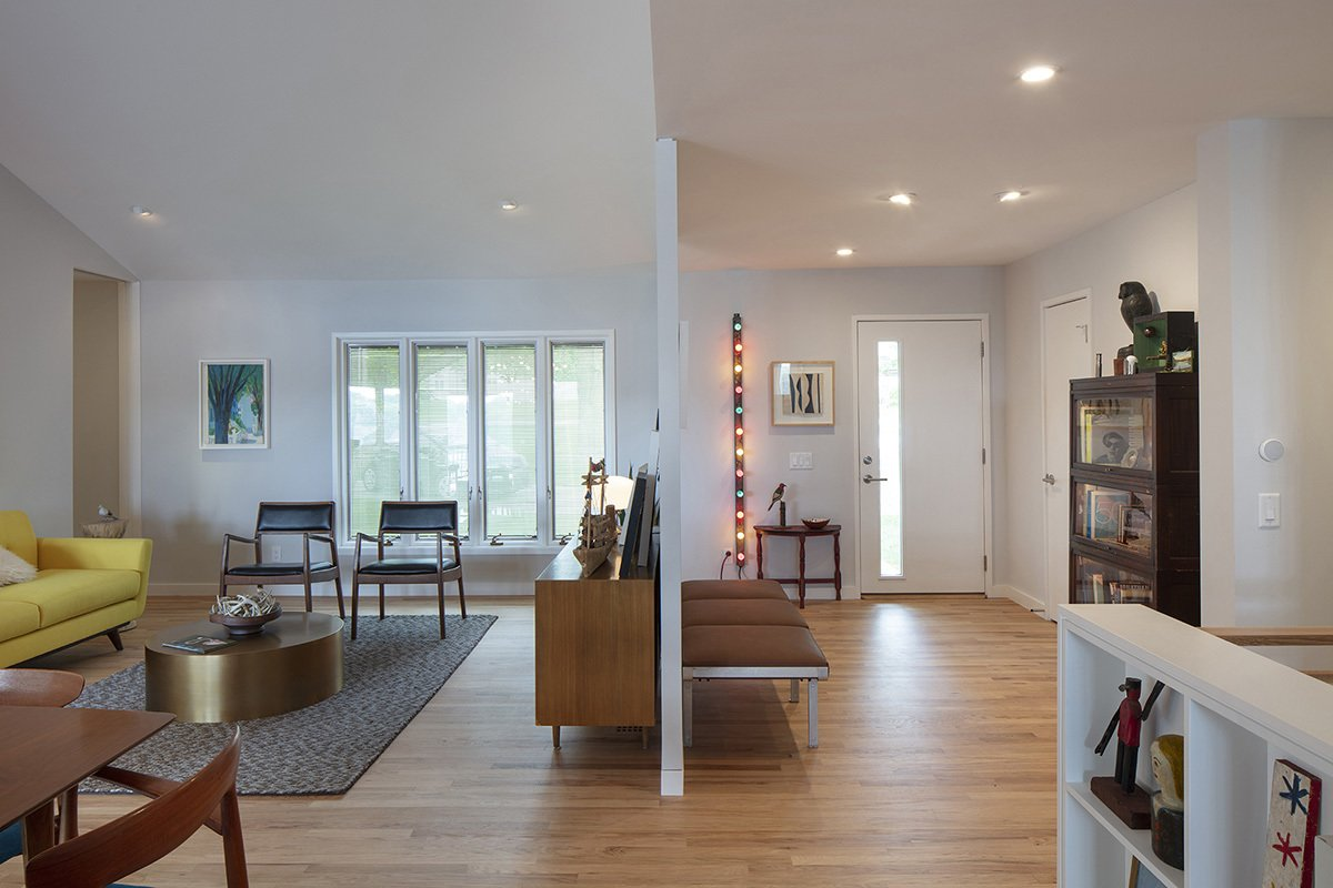 Living Room, End Tables, Bench, Chair, Sofa, Coffee Tables, Storage, Wall Lighting, Light Hardwood Floor, Recessed Lighting, Ceiling Lighting, Bookcase, and Console Tables Front entry and living area.  Photos from Gallery Residence