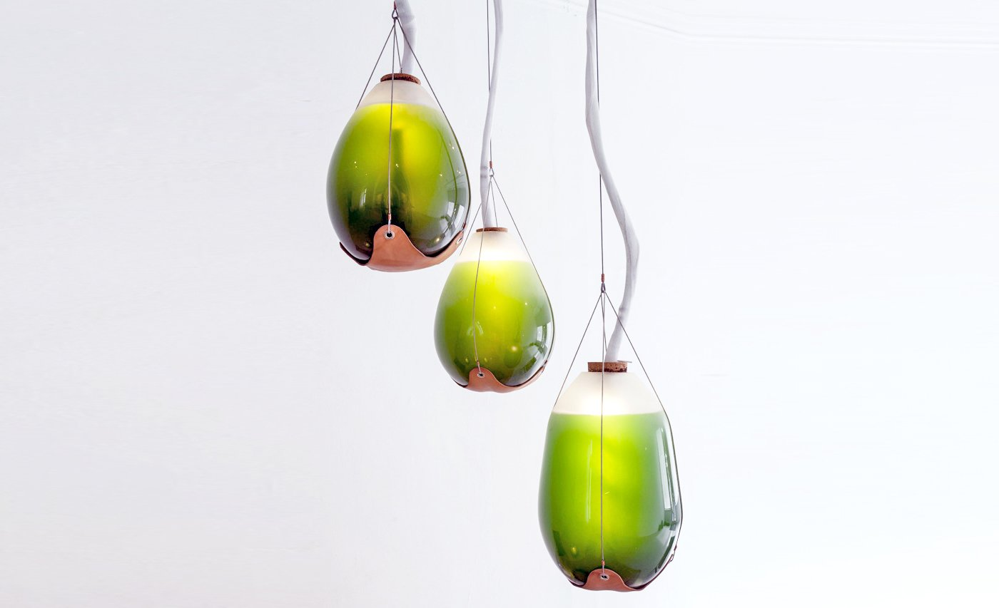 """Jacob Douenias and Ethan Frier -Livings Things: Spirulina Pendant Lamps  """"The morphologies of hand-blown glass vessels function both as lighting and heating elements for the human occupants, and high functioning photobioreactors which provide heat, light, agitation, air supply, nutrient and waste control to the living algae inside,""""   Material Spotlight: Algae"""