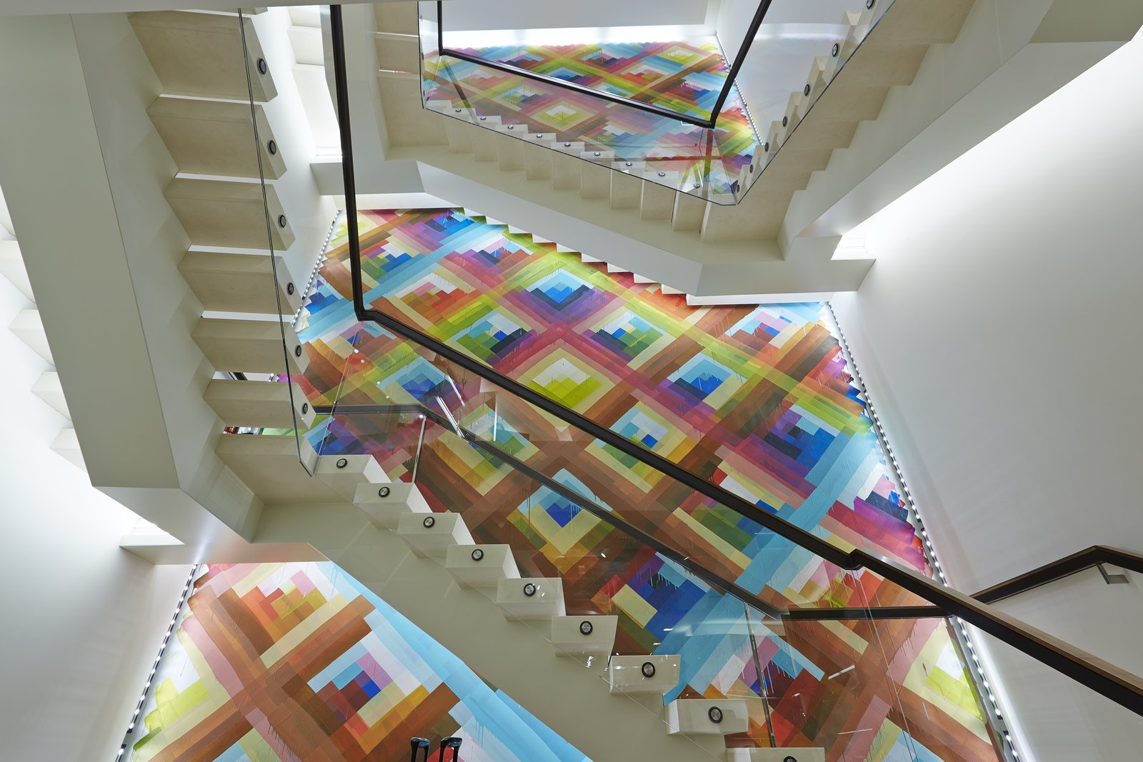 The mural measures roughly 39 feet high by 16 feet wide, its colorful tessellation the backdrop against which other architectural elements cohere.  Photo 4 of 5 in Mural Artist Sets the Scene at Longchamp's Flagship Store in London