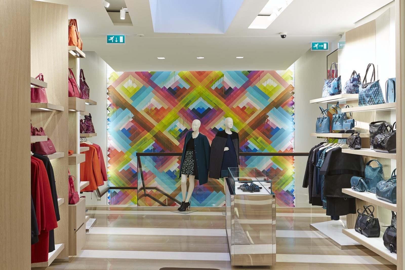 The prismatic hues of Maya Hayuk's mural complement the hot and cool tones of the merchandise lining the walls.  Photo 2 of 5 in Mural Artist Sets the Scene at Longchamp's Flagship Store in London