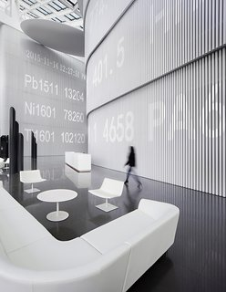 A ticker runs along the wall, superimposing digitally the work done in physical space.