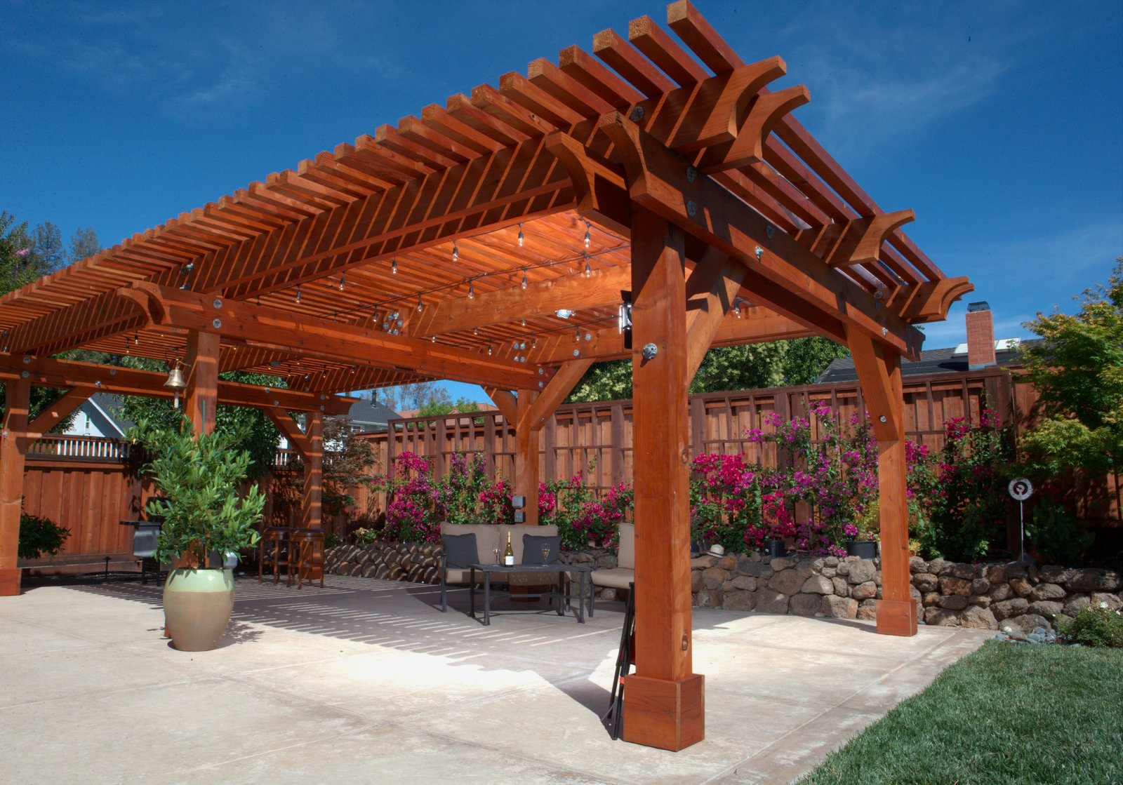A versatile material, redwood can be left to turn a rustic, silver-tone gray, or finished to take on a glowing tint. A pergola such as this one, which will accompany Humboldt Redwood Company at Dwell on Design, can imbue your backyard space with both stateliness and charm.  Photo 7 of 7 in Beauty and Brains: Building Sustainably With Redwood