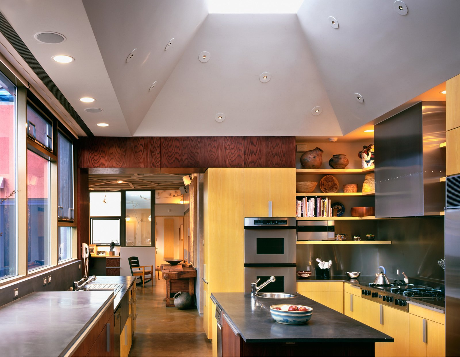 The kitchen features poured concrete counters, double convection ovens, and dual warming drawers and dishwashers.  Photo 6 of 9 in The Intersection of Art and Architecture Offered for $3.75M