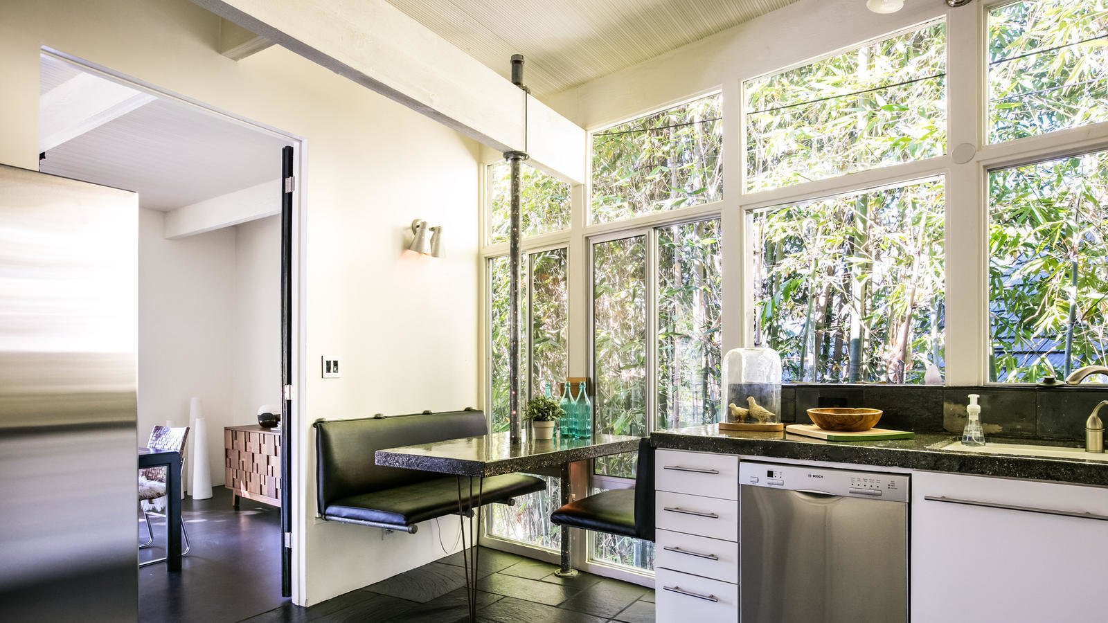 Booth seating in the eat-in kitchen creates a cozy nook behind a private bamboo fence.  Photo 5 of 10 in Own a Piece of Hollywood History for $1.995M