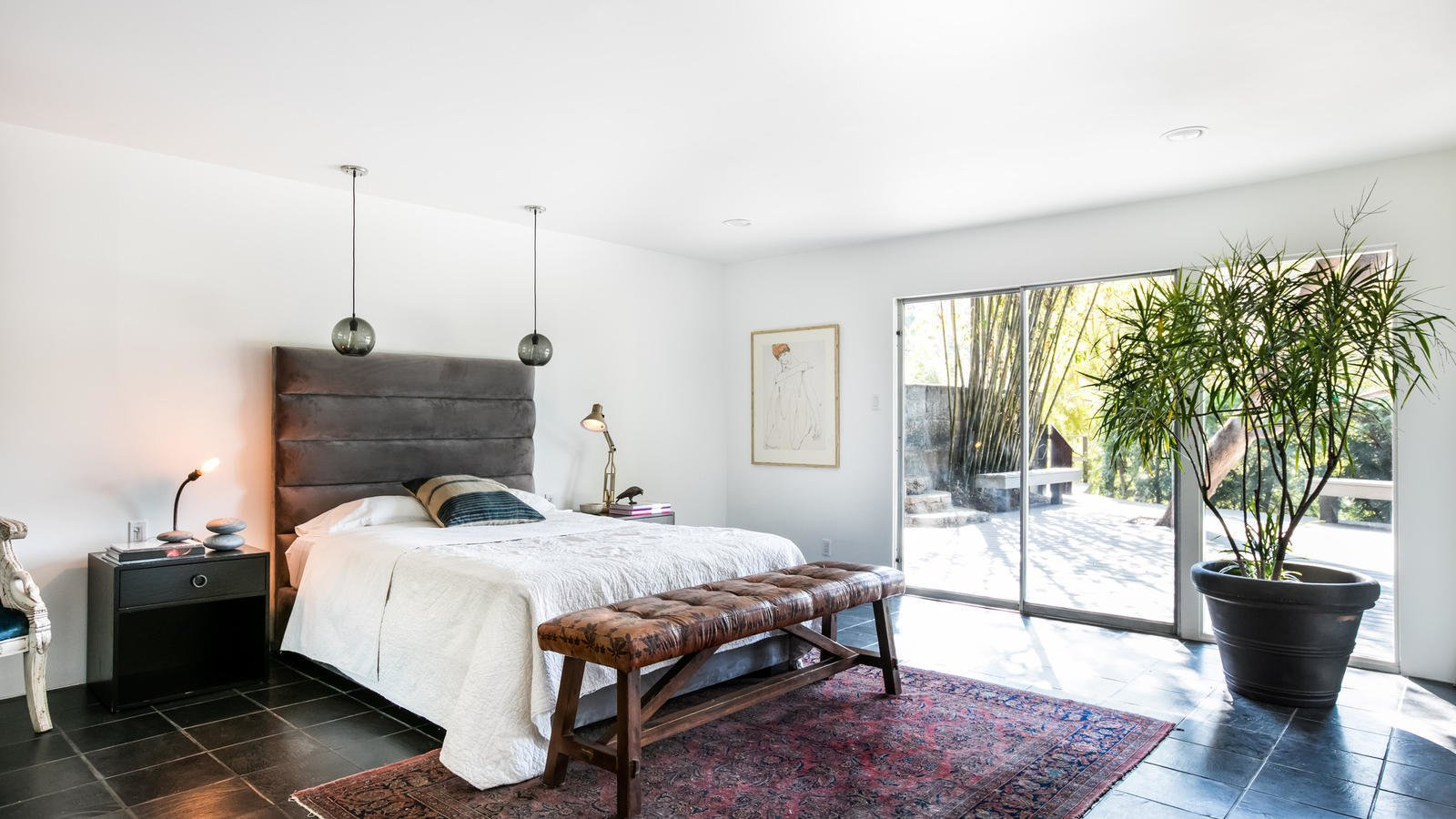 A downstairs bedroom opens out to a spacious deck.  Photo 6 of 10 in Own a Piece of Hollywood History for $1.995M