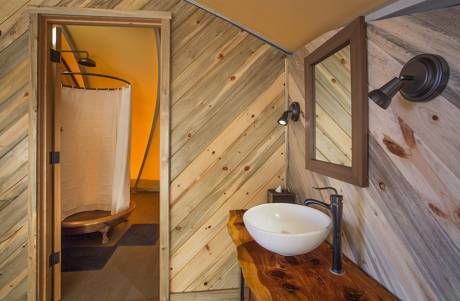 Bath, Vessel, Medium Hardwood, Wood, Wall, and Enclosed The Autonomous Tent runs on Treebones Resort's water supply. Solar panels power the LED lights, pumps, water filters, and a composting system.  Bath Enclosed Medium Hardwood Wood Photos from Sleep in a Translucent Cocoon for $495 a Night